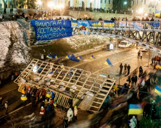 Protesters have erected barricades in central Kiev.