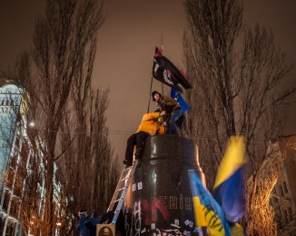 protesters tore down a statue of Lenin, a potent symbol of Moscow's historical dominance over this former Soviet republic.