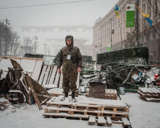 ne man in front of a  Barricade defended by Pro-European Union activists next to the Independence Square  in Kiev, Ukraine, Monday, Dec. 9, 2013.
