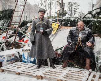 Two Cossacks on Barricade defended by Pro-European Union activists next to the Independence Square  in Kiev, Ukraine, Monday, Dec. 9, 2013.