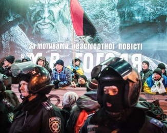 During the Pro-government meeting at the European square, Pro-european supporters call out people, behind riot police. Kiev. Ukraine.  Dec 14th 2013.
