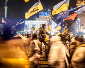 Pro-European Union activists  are protecting the entrance of  the Maidan camp. Independence Square  in Kiev, Ukraine, Demonstration in Kiev against Ukraine's rejection of the EU agreement. dec 15th 2013. Kiev. Ukraine