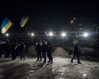 Pro European supporters in front of a barricade. Riot police stormed Kiev protest camp in early morning raid. dec 11th 2013. Demonstration in Kiev against Ukraine's rejection of the EU agreement
