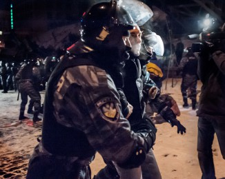 A Pro-European supporter is arrested during that the riot police stormed Kiev protest camp in early morning . dec 11th 2013. Demonstration in Kiev against Ukraine's rejection of the EU agreement.