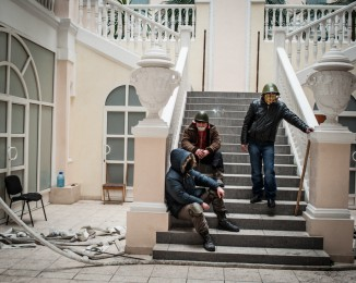 Anti-government protestors stand inside the occupied Ministry of Justice on January 27, 2013 in Kiev, Ukraine.