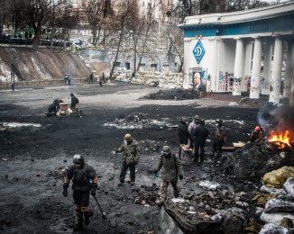The doors of the Dynamo Stadium are become a buffer zone between protesters and police on Hrushevs'koho Street on January 28, 2014 in Kiev, Ukraine.
