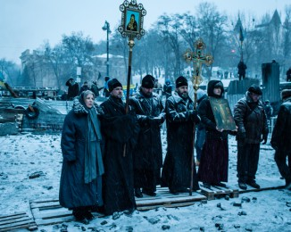 Orthodox Christian priests say prayers on Hrushevskoho Street Jan. 21 in the zone separating police from protesters.