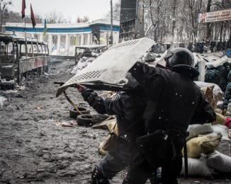 An early-morning police raid on Jan. 22 left five protesters dead, including four from gunshot wounds. Police charged protests lines twice more throughout the day, pushing back demonstrators before retreating. Stand off enter European Activists and the police  at the conflict zone of Hrushevskoho Street .  January22th 2014. Kyiv Ukraine.