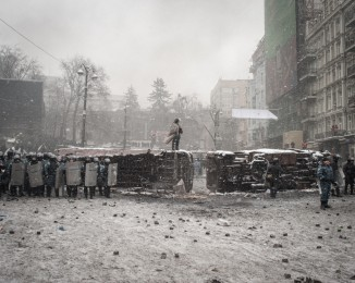 An early-morning police raid on Jan. 22 left five protesters dead, including four from gunshot wounds. Police charged protests lines twice more throughout the day, pushing back demonstrators before retreating. . Stand off enter European Activists and the police  at the conflict zone of Hrushevskoho Street .  January22th 2014. Kyiv Ukraine.
