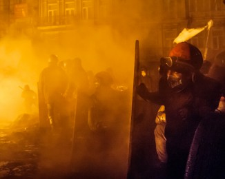 Anti-government protesters clash with the police in the center of Ukrainian capital Kyiv during the night on January 25, 2014.