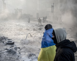 Anti-government protesters on the barricade Aduring clashes with police on Hrushevskoho Street near Dynamo stadium on January 25, 2014 in Kyiv, Ukraine. After two months of primarily peaceful anti-government protests in the city center, new laws meant to end the protest movement have sparked violent clashes in recent days.