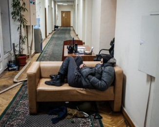 A demonstrator is sleeping Inside the agriculture ministry occupied by the anti-government protesters. Protesters have been camped out on Independence Square since November. January 24th 2014. Kyiv. Ukraine