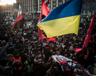 Ultra-nationalist UNA-UNSO fighters carry the coffin of Mykhaylo Zhuznevskiy,an activist killed during clashes on Hrushevskoho Street on Jan. 22,  through Independence Square on January 26, 2013 in Kiev, Ukraine.