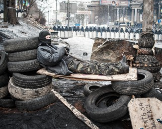 An anti-government protester stands on a barricade in Hrushevskoho Street.  Kyiv, on February 11, 2014. Ukraine.