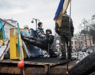 Anti-government protesters stands on a barricade in Hrushevskoho Street.  Kyiv, on February 11th, 2014. Ukraine.