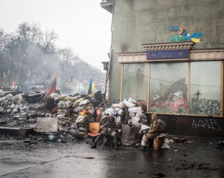 Anti-government protesters stand on a barricade in Hrushevskoho Street.  Kyiv, on February 13, 2014. Ukraine.