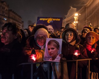 Thousands of Ukrainian people attend a rally and listen as former Ukrainian Prime Minister Yulia Tymoshenko delivers a speech at the Independence Square after her release in the capital in Kyi6v, Ukraine on February 22, 2014. Tymoshenko, who was in prison since August 2011, was convicted and sentenced to seven years imprisonment for abusing her powers as prime minister by ordering Ukrainian Naftogaz to sign a gas deal with Russia in 2009.