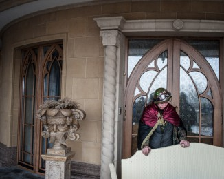 Anti-government protesters guard an entrace to a house on President Viktor Yanukovych's Mezhyhirya estate, which was abandoned by security, on February 23, 2014 in Kyiv, Ukraine.