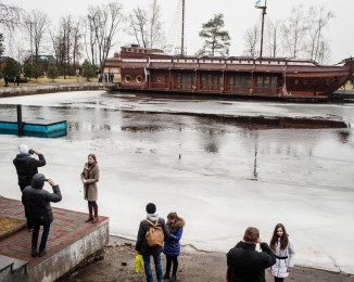 A replica galleon stands on an artificial waterway as people roam Mezhyhirya, the sprawling President Yanukovych's countryside residence compound on February 23, 2014 in Kyiv, Ukraine.