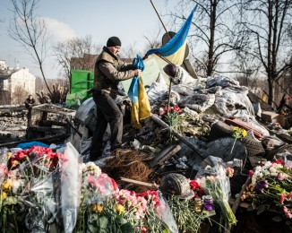 an anti-government protestor on a barricade which became a memorial to the victims of the past weeks' riots on Institutska street behind the Ukraine hotel on February 23, 2014 in Kyiv, Ukraine.