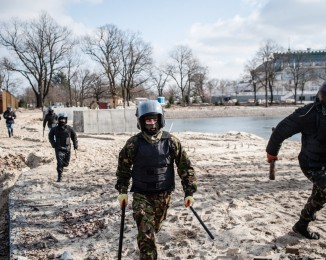 A group of Maidan activists invade a construction site for luxurious mansions allegedly connected to former Ukkrainian president Yanukovich's family and close circle in Koncha Zaspa area near Kiev. Without looting, they searched for documents incriminating Yanukovich in the financing of this extravagant housing compound. feb 24th. Kyiv. Ukraine.