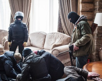 A group of Maidan activists lead by journalist Tetyana Chornovol visit a lavish log house belonging to multimillionaire businessman Sergey Kurchenko in search for documents connecting his business to former Ukrainian President Viktor Yanukovych family on February 25, 2014 in Kyiv, Ukraine.