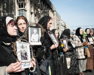 women  pay homage to anti-government protestors killed by the police during the riots of the week. Independance square. Kyiv. Ukraine. february 266th 2014.