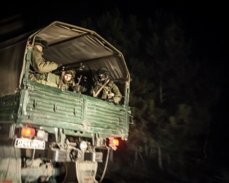 A convoy of 20 Russian armoured personnel carriers and trucks full of troops pictured in the evening 3km from Simferopol of Crimea where they are reportedly heading on February 28, 2014 near Simferopol, Crimea, Ukraine. According to media reports Russian soldiers have occupied the airport at nearby Sevastapol while soldiers whose identity could not be initally confirmed have stationed themselves at Simferopol International Airport in moves that are raising tensions between Russia and the new Kiev government. Crimea has a majority Russian population and armed, pro-Russian groups have occupied government buildings in Simferopol.February. 28th 2014. Simferopol. Crimea. Ukraine.
