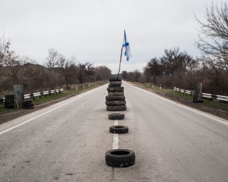 Checkpoint manned by Crimean civilian self-defense members on a road leading to Sevastopol. in Crimea on March 2, 2014 near Verkhn'osadove, Ukraine.