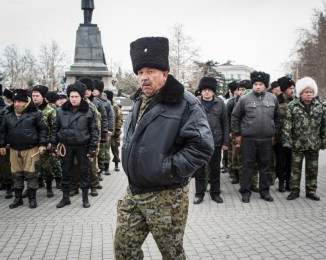 At the end of a pro-russian meeting, around 200 cossacks from russia come to to take an oath in city police officers to protect Sevastopol. They will make nightly checks with the police. Sevastopol. Crimea. Ukraine. March 2.