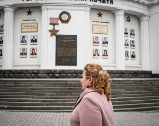 A woman walks in front of the honor monument for the best employes of the Sevastopol city. Sevastopol. Crimea. Ukraine. March 2.