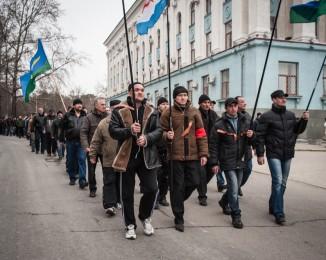Crimean civilian self-defense members rally on March 1, 2014 in Simferopol, Ukraine. Crimea