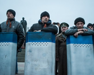 Crimean civilian self-defense members outside the Crimean parliament building on March 1, 2014 in Simferopol, Ukraine. Crimea.