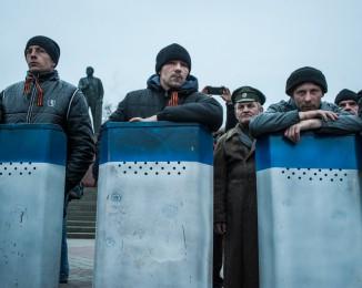 Crimean civilian self-defense members outside the Crimean parliament building on March 1, 2014 in Simferopol, Ukraine. Crimea.