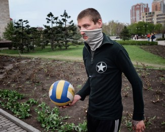 DONETSK - APRIL 19, 2014 -10:36AM A pro-Russian militant plays soccer in front of the Donetsk Regional State Administration Building.