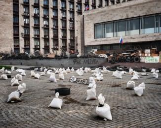 DONETSK - APRIL 19, 2014 - 10:52AM Barricades surround the Regional State Administration Building. The building, occupied by the separatists, has become the headquarters of the Donbass People's Republic.