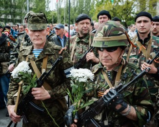 DONETSK - MAY 9, 2014 -11:44AM Members of the Vostok militia  parade during a pro-Russian meeting in Lenin Square.