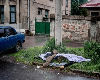 MARIUPOL - MAY 9, 2014 - 2:46PM The body of a man lies in front of the police station, following a fight between pro-Russian militia and the National Guard of Ukraine.