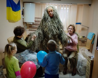 MARIUPOL - Sep 29th 2014 - 2:57PM. Women make a camouflage dress uniform for Snipers inside the office of the Novy Mariupol, an organization that collects equipment for Ukrainian soldiers.
