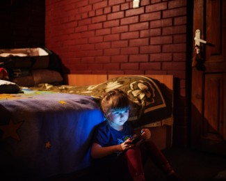LVIV-February 24th 2015-6:33PM, Aliya, 6, lives with her brother, Alan, and her mother, Suzanna, at the Katerina hotel. Her family is tatar. She had to leave Crimea in december 2014 after the russian annexation of the peninsula.