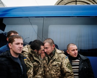 TERNOPIL-February 25th-4:17PM- Ukrainian soldiers say goodbye to each other before joining their families at the bus station after to have spent several months on the front line in the city of Debaltseve in the east of Ukraine.