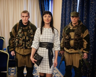 DONETSK - March 7th 2015- 2:38 PM - A wife of an Ataman (Cossack lea- der) of the Don (river) flanked by her bodyguards after the military miss election of the DNR (self-proclaimed Republic of Donetsk) at the Hotel Shakhtar Plaza in Donetsk.