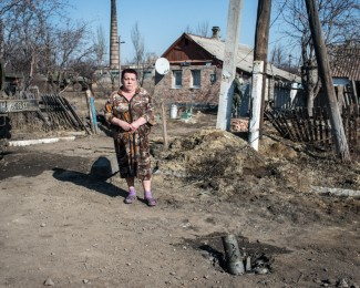 DEBALTSEVE-Donbass-March 9th 2015-13h22 - A woman in front of her house, a few hundred yards away from the town's former front line where fighting occured betwen the pro-russian forces and the Ukrainian army. In february, the pro-russian forces had besieged with continuous bombing, althrough the Minsk 2 agreement had just been signed. The Ukrainian army had to surrender the town to the DNR forces.