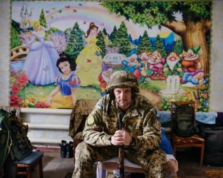 AVDIIVKA- February 24th 2017-13: 44 Volodymyr, 38, press officer of the Ukrainian army poses in the dormitory of the military press office of the 72nd Regiment located in an old crèche.
