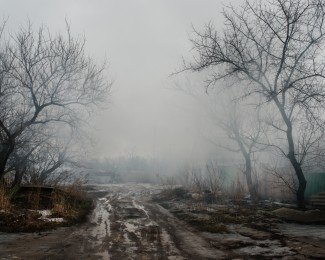 AVDIIVKA- February 25th 2017-10: 43 AM Chernichevskogo street in the old town of Avdiivka smoked by the fire of a house affected by bombing during the night of 24 to 25 February 2017. The front line is 300 meters at the end of the street.