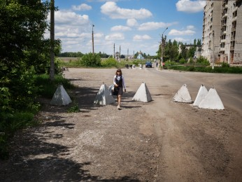 AVDIIVKA- May 26th, 2017-10: 55 AM A schoolgirl returns to her neighborhood of the old town of Avdiivka passing by a Ukrainian military checkpoint located a few hundred meters from the front line.