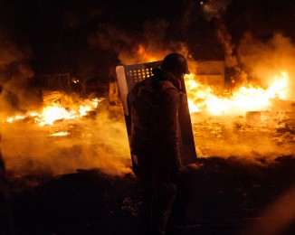 KIEV - HRUSHEVSKOHO STREET - JANUARY 22, 2014. 6:43PM Pro-EU protesters make a wall of fire by burning tires to stop law enforcement from attacking.